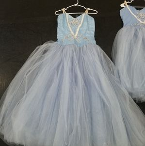 A lot of 9 romantic style Tutus.